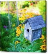 Birdhouse And Flowers Canvas Print