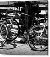 Black And White Leaning Bikes Canvas Print