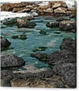 Black Rocks On Blue Water Canvas Print