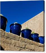 Blue Pottery On Wall Canvas Print