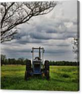 Blue Tractor Green Field Canvas Print