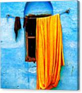 Blue Wall With Orange Sari Canvas Print
