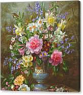 Bluebells Daffodils Primroses And Peonies In A Blue Vase Canvas Print