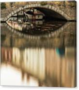 Boat Waddling On Water Channels Of Bruges, Belgium Canvas Print