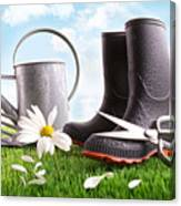 Boots With Watering Can And Daisy In Grass  Canvas Print
