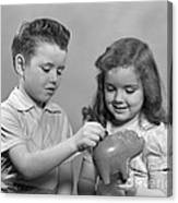 Boy And Girl Putting Money Into Piggy Canvas Print