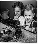 Boy And Girl With Train Set, C.1950s Canvas Print
