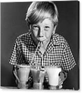 Boy Drinking Three Shakes At Once Canvas Print