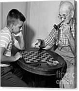 Boy Playing Checkers With Grandfather Canvas Print