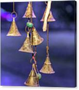 Brass Bells Hanging In The Illuminated Courtyard At Winter Night Canvas Print