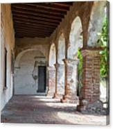 Brick And Stone Arches Line Walkway In Old Mission Ruin Canvas Print