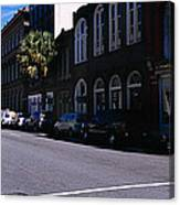 Buildings On Both Sides Of A Road Canvas Print