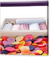 Buttons And Textile Fabrics In A Sewing Box Canvas Print
