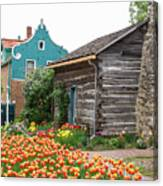Cabin By The Tulips Canvas Print