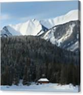 Cabin On Frozen Lake Canvas Print