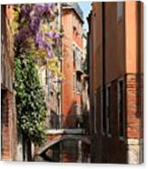 Canal In Venice With Flowers Canvas Print