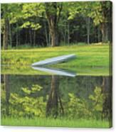 Canoe At Ponds Edge Canvas Print