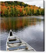 Canoe On A Lake Canvas Print