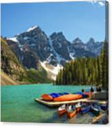 Canoes On A Jetty At  Moraine Lake In Banff National Park, Canada Canvas Print