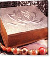 Carved Box In Aluminum. Silver Box And Red Necklace Canvas Print
