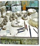 Ceramic Objects And Brushes On The Table Canvas Print