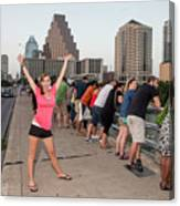 Cheerful Attractive Female Austinite Waves Her Hands With Excitement On Seeing The Austin Bats Canvas Print