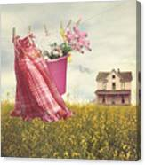 Child's Dress And Toys Hanging On Line With Farmhouse In Backgro Canvas Print