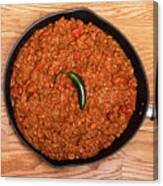 Chili In Black Pan On Wood Table With Jalapeno Pepper Canvas Print