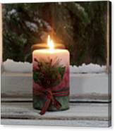 Christmas Candle Glowing On Window Sill With Snowy Evergreen Bra Canvas Print