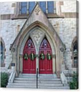 Christmas Wreaths On Red Church Doors Canvas Print