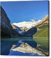 Clear Reflections In The Water At Lake Louise, Canada. Canvas Print