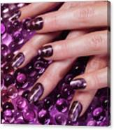 Closeup Of Woman Hands With Purple Nail Polish Canvas Print