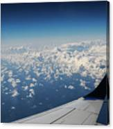 Clouds Under An Airplane Wing Canvas Print