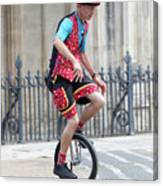 Clown Riding Unicycle In Town Canvas Print
