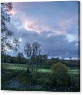 The Evening Is Fallen Over The Meadow Colouring The Sky Pink And Blue. Canvas Print