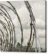 Coils Of Razor Wire On Fence Canvas Print