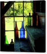 Colored Bottles On Steps Canvas Print