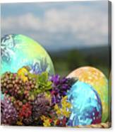 Colored Easter Eggs In Basket And Spring Flowers Canvas Print