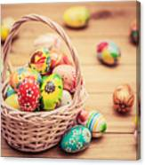 Colorful Hand Painted Easter Eggs In Basket And On Wood Canvas Print