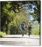 Couple Enjoying A Back Road Bike Ride Canvas Print