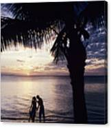 Couple Silhouetted On Beach Canvas Print