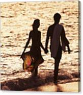 Couple Wading In Ocean Canvas Print