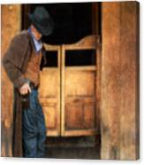 Cowboy By Saloon Doors Canvas Print
