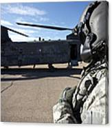 Crew Chief Of A Ch-47 Chinook Stands Canvas Print