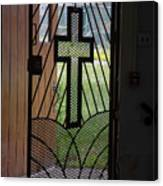 Cross On Church Door Open To Prison Yard Fence With Razor Wire Canvas Print