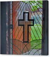 Cross On Church Door Open To Prison Yard With Light Canvas Print