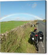 Cycling To The Rainbow Canvas Print