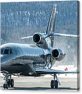 Dassault Falcon 900 Parking With Marshaller Canvas Print