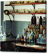 Desk With Bottles Of Chemicals Canvas Print