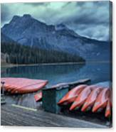 Emerald Lake Canoes Canvas Print